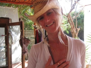 Shiva wearing Medicine Buddha earrings in Tulum Mexico shopping Freeravin Designs.