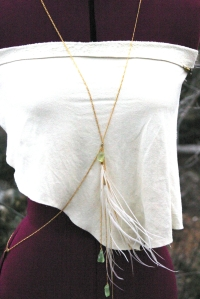 Sexy and adorned with feathers and sea glass this body chain is the perfect addition to your everyday style.